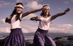 gils dancing hula on ocean